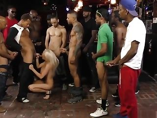 Huge-chested Nymph With Faux Lips Gets Gang-bang With 13 Blacks