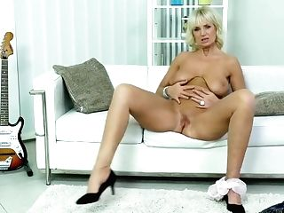 Roxana Is A Big Titted Granny Who Likes To Masturbate While Wearing Boots With High High-heeled Slippers